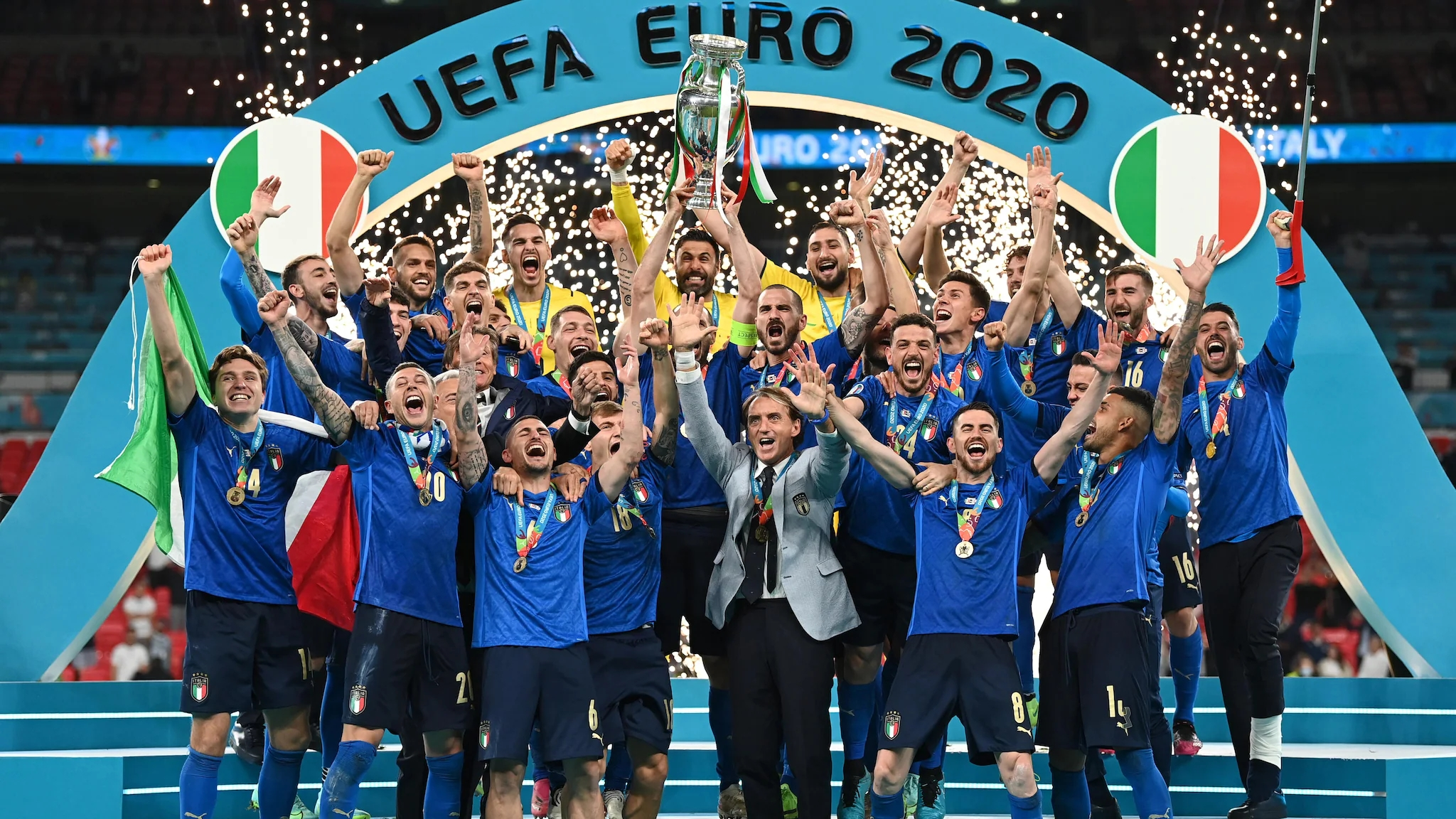 It's coming to Rome!  Italy holds up the trophy